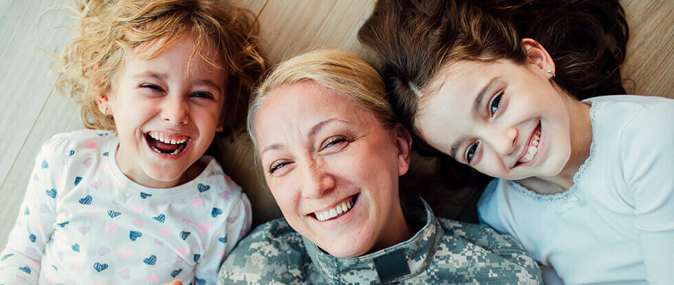 service woman playing with her daughters