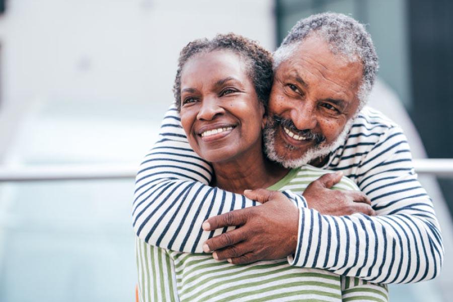 Smiling older black couple